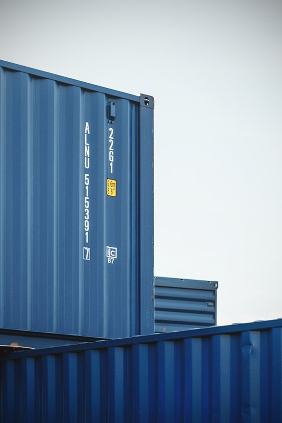 stack of blue shipping containers
