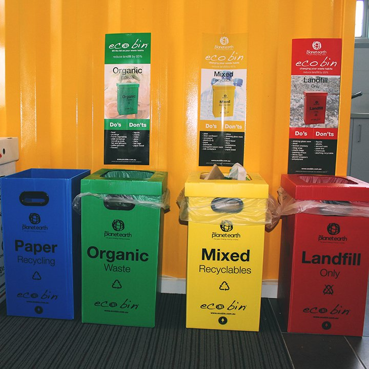 colorful recycle trash bins inside a container office