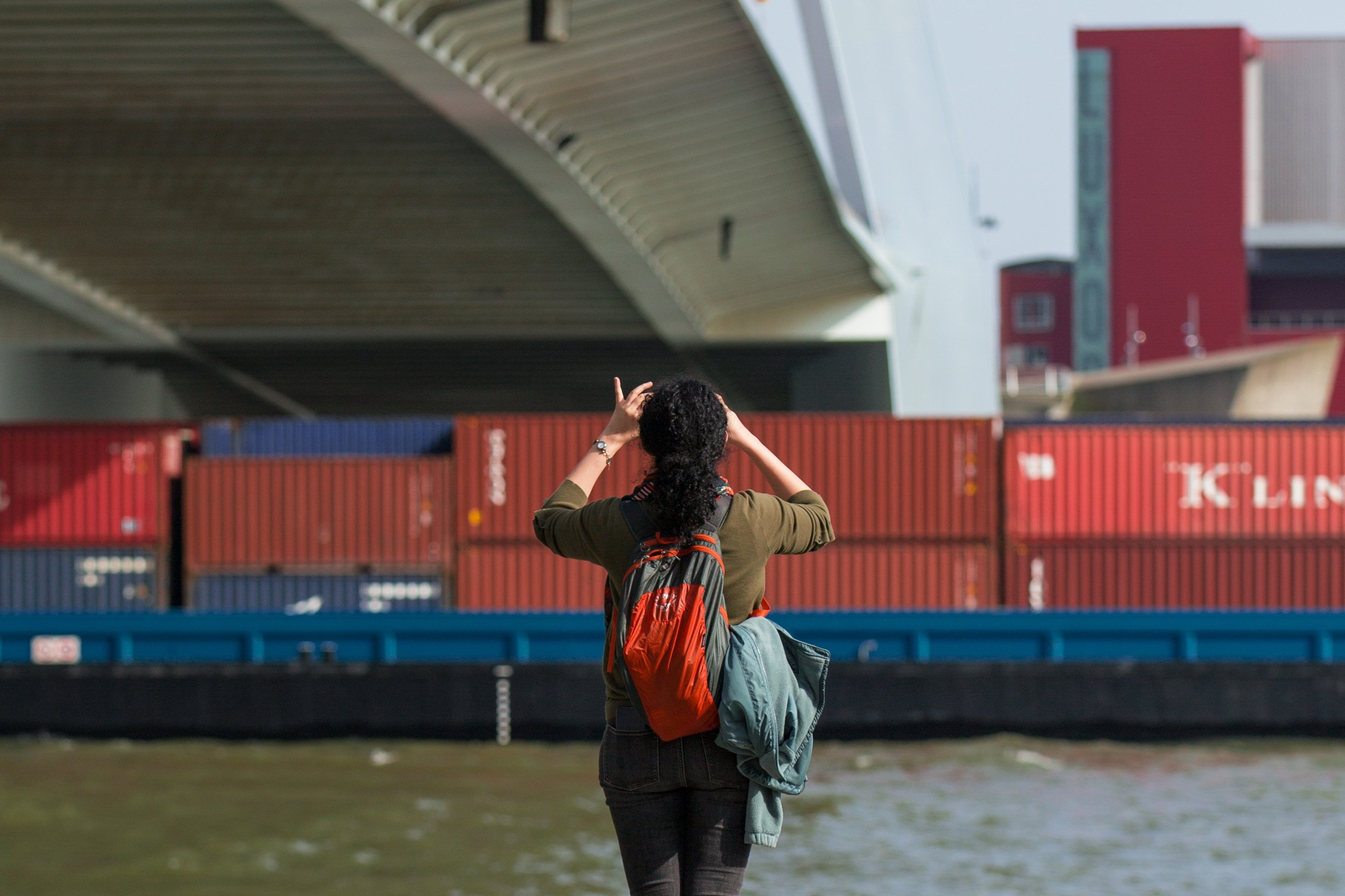 Woman taking a picture of shipping containers