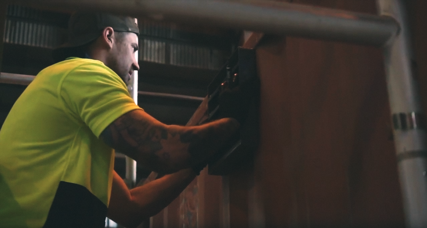 Man installing vent on shipping container