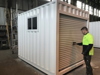 man inspecting a shipping container